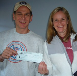 $1000 check to Kristen Randall of Durham Parks and Rec.!