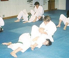 Sam practicing armbars as a green belt!